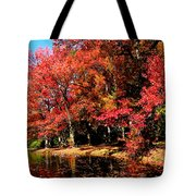 Red Trees By Lake Tote Bag
