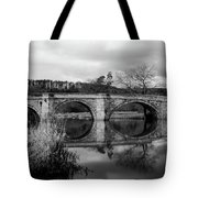 Reflecting Oval Stone Bridge In Blanc And White Tote Bag by Dennis Dame