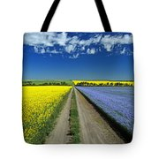 Road Through Flowering Flax And Canola Tote Bag