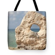 Rock With A Hole With A Tropical Ocean In The Background. Tote Bag