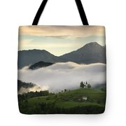 Rolling Fog At Sunrise In The Skofjelosko Hills With St Thomas C Tote Bag
