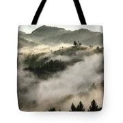 Rolling Fog At Sunrise In The Skofjelosko Hribovje Hills With St Tote Bag
