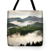 Rolling Fog At Sunrise With Mountains Of Kamnik Savinja Alps At  Tote Bag