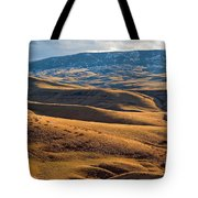 Rolling Foothills And The Bighorn Mountains Tote Bag
