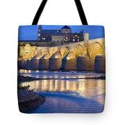 Roman Bridge On Guadalquivir River At Dawn Tote Bag
