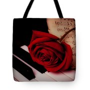 Rose With Sheet Music On Piano Keys Tote Bag