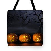Row Of Halloween Pumpkins In A Spooky Forest At Night Tote Bag