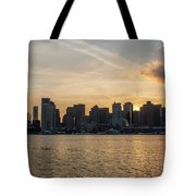Seagull Flying At Sunset With The Skyline Of Boston On The Backg Tote Bag