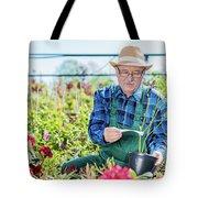 Senior Gardener Selecting A Tree. Tote Bag