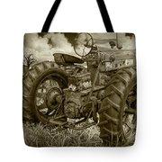 Sepia Toned Old Farmall Tractor In A Grassy Field Tote Bag