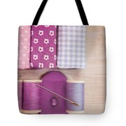 Sewing Threads Needle And Fabrics On A Wooden Box Tote Bag