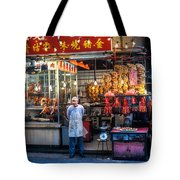 Shop Owner Standing In Front Of Poultry Shop On Temple Street Night Market Kowloon Hong Kong China Tote Bag