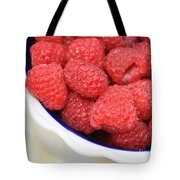Side View Of Rasberries In Blue Bowl Tote Bag