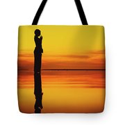 Silhouette Of A Girl Practicing Yoga Reflected On The Surface Of Water During Beautiful Sunset Tote Bag