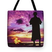 Silhouette Of A Local Man Standing By The Bonfire On The Beach In Maldives During Dramatic Sunset Tote Bag