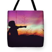 Silhouette Of A Playful Boy Pointing With Finger In The Field During Beautiful Sunset Tote Bag
