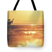 Silhouette Of A Thai Fisherman Wooden Boat Longtail During Beautiful Sunrise Tote Bag