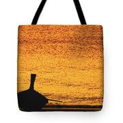 Silhouette Of A Thai Wooden Boat  On The Beach Against Golden Sunset Koh Lanta, Thailand Tote Bag