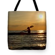 Silhouette Of Woman Kayaking In The Ocean. Tote Bag
