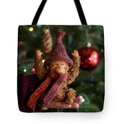 Silly Old Monkey Toy In A Child Hands Under The Christmas Tree Tote Bag