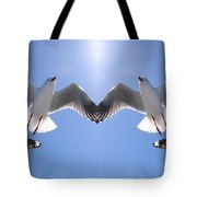 Six Heavenly Backlit Seagulls Flying Overhead In Blue Sky. Tote Bag