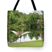 Skipping Sandhill Crane By Pond Tote Bag