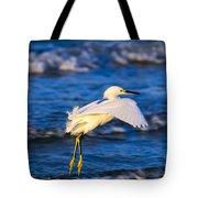 Snowy Egret Lands In Surf Tote Bag