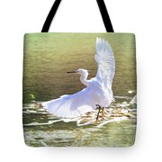 Snowy Egret Over Golden Pond Tote Bag