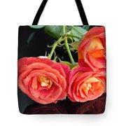 Soft Full Blown Red-orange Roses On Black Background. Tote Bag