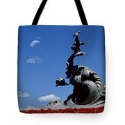 Statue And Tulips Against A Clear Blue Tote Bag