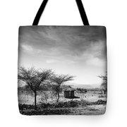 Stone Hut Set In Grassland Plains Tote Bag by David DuChemin