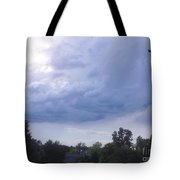 Storm Clouds Passing Through Tote Bag