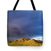Storm Rolling Across Sun Dappled Mountains Tote Bag