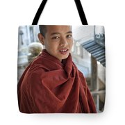 Street Portrait Of A Young Monk Tote Bag