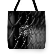 Stuck In A Fence Tote Bag