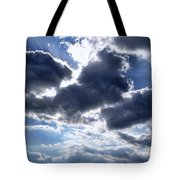 Sun Breaking Through The Clouds Tote Bag by Mariola Bitner