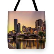 Sunset Over Skyscrapers Of Melbourne Downtown And Princes Bridge Tote Bag