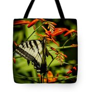 Swallowtail Hanging On The Crocosmia Tote Bag