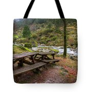 Tables By The River Tote Bag by Carlos Caetano