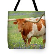 Texas Longhorn Standing In Bluebonnets Tote Bag by Jon Holiday