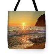 the beach and the Mediterranean sea in Montenegro in the summer at sunset Tote Bag
