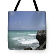 The Caribbean Sea Is Seen From A Rocky Tote Bag