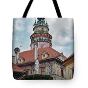 The Cesky Krumlov Castle Tower With A Fountain Below Within The Czech Republic Tote Bag