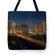 The Glimmering Neon Lights Of The Downtown Austin Skyscrapers Illuminate The Skyline Over Lady Bird Lake Tote Bag