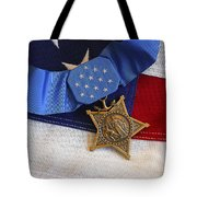 The Medal Of Honor Rests On A Flag Tote Bag