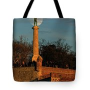 The Moon Rising Behind The Victor Statue In Belgrade In The Golden Hour Tote Bag