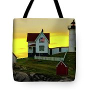 The Nubble Cape Neddick Lighthouse In Maine At Dawn Tote Bag