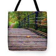 the old bridge over the river invites for a leisurely stroll in the autumn Park Tote Bag
