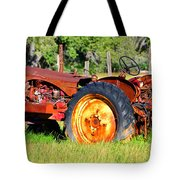 The Old Tractor In The Field Tote Bag