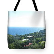 the panorama of the ancient castle on a rock, the symbol of the Republic of Crimea on the background Tote Bag